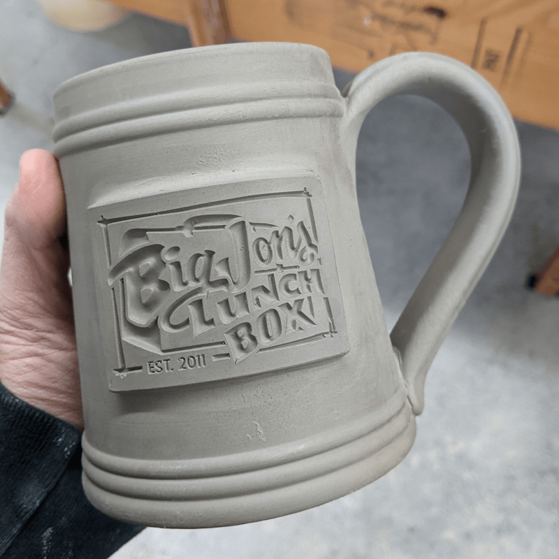 clay beer stein big johns lunch box logo